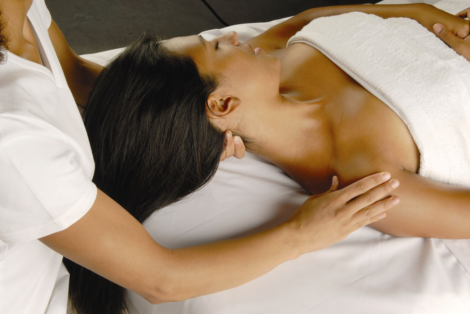 Picture of young woman getting massage.
